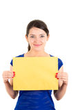 Beautiful young woman holding yellow blank sign Royalty Free Stock Photo