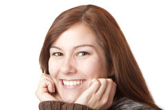 Beautiful young woman holds chin and smiles happy Royalty Free Stock Photos