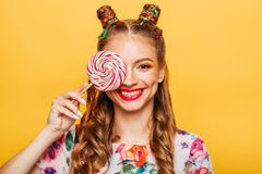 Beautiful young woman holds in hand candy Stock Photos