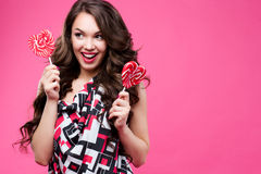 Beautiful young woman holds in hands candy smiling broadly.  Stock Images