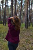 Beautiful young woman holds her hair on hands. Back view royalty free stock photo