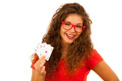 Beautiful young woman holds poker cards four aces isolated over. White background Stock Photography