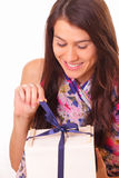 Beautiful young woman with holiday gift Stock Photography