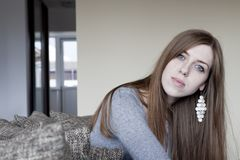 Beautiful young woman at home Royalty Free Stock Photos
