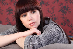 Beautiful young woman at home casual and relaxed Royalty Free Stock Image