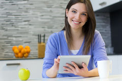 Beautiful young woman at home with digital tablet Stock Photography