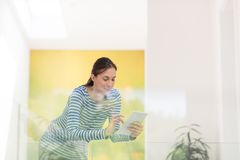 Young woman at home websurfing Royalty Free Stock Photography
