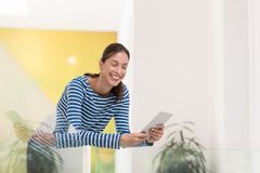 Young woman at home websurfing Royalty Free Stock Image