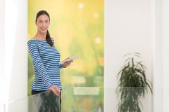 Young woman at home websurfing Stock Images