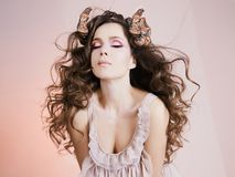 Beautiful young woman with Horns Stock Images