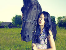 Beautiful young woman and horse. Fashionable portrait of a beautiful young woman and horse Royalty Free Stock Photos