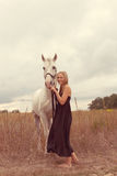 Beautiful young woman with a  horse Stock Photography