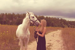 Beautiful young woman with a  horse Stock Photos