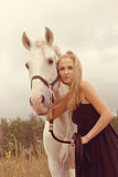Beautiful young woman with a  horse Royalty Free Stock Photo