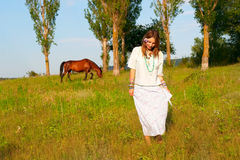 Beautiful young woman and horse Royalty Free Stock Photo