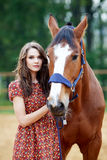 Beautiful young woman with a horse stock image