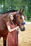Beautiful young woman with a horse. Outdoor royalty free stock photos