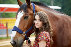 Beautiful young woman with a horse. Outdoor royalty free stock photography