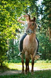Beautiful young woman on horseback Stock Photography