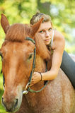 Beautiful young woman on horseback Royalty Free Stock Images