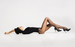 Beautiful, young woman in hosiery laying on the floor Stock Photos