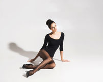 Beautiful, young woman in hosiery sitting on the floor Royalty Free Stock Photography