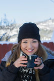 Beautiful young woman with hot chocolate Stock Photography