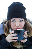 Beautiful young woman with hot chocolate Stock Image
