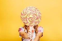 Woman with huge candy instead of a head Stock Photos