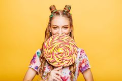 Woman with huge candy instead of a head Stock Image