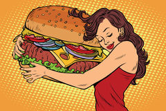 Beautiful young woman hugging Burger. Pop art retro vector vintage illustration. Fast food restaurant, diet and hunger Stock Photos