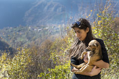 Beautiful young woman hugging a dog. Happy girl  hugging dog outdoor Royalty Free Stock Photography