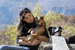Beautiful young woman hugging a dog. Happy girl  hugging dog outdoor Stock Photo