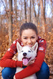 Beautiful young woman hugging huskies puppy for a walk in the park Stock Images