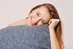 Beautiful young woman hugging a pillow Stock Images