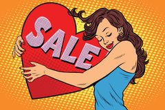 Beautiful young woman hugging sale Valentine heart Stock Images