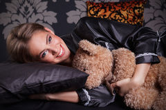 Beautiful young woman hugging a teddy bear Stock Image