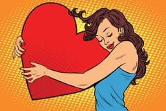 Beautiful young woman hugging Valentine heart Stock Photo