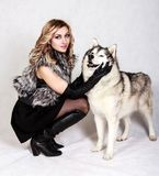 Beautiful young woman with a husky dog Stock Photo