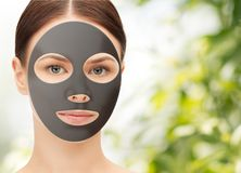 Beautiful young woman with hydrogel mask on face stock photography