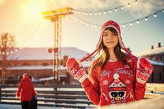 Beautiful young woman on the ice rink, smiling in the sun royalty free stock photography