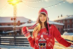 Beautiful young woman on the ice rink, smiling in the sun stock photography