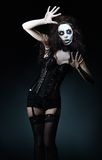 Beautiful young woman in the image of sad gothic freak clown Royalty Free Stock Image