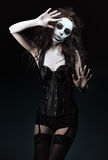 Beautiful young woman in the image of sad gothic freak clown Stock Photography