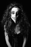 Beautiful young woman in the image of sad gothic freak clown. Black and white Royalty Free Stock Photo