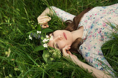 Free Beautiful Young Woman In Green Spring Grass Royalty Free Stock Photo - 76263355
