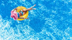 Free Beautiful Young Woman In Hat In Swimming Pool Aerial Top View From Above, Girl In Bikini Relaxes And Swim On Inflatable Ring Donut Royalty Free Stock Photo - 152912225