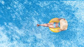 Free Beautiful Young Woman In Hat In Swimming Pool Aerial Top View From Above, Young Girl In Bikini Relaxes On Inflatable Ring Royalty Free Stock Images - 156888099