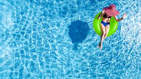 Free Beautiful Young Woman In Hat In Swimming Pool Aerial Top View From Above, Young Girl In Bikini Relaxes On Inflatable Ring Royalty Free Stock Images - 156889879