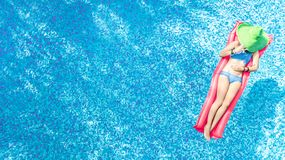 Free Beautiful Young Woman In Hat In Swimming Pool Aerial Top View From Above, Young Girl In Bikini Relaxes On Inflatable Ring Royalty Free Stock Photos - 156990878